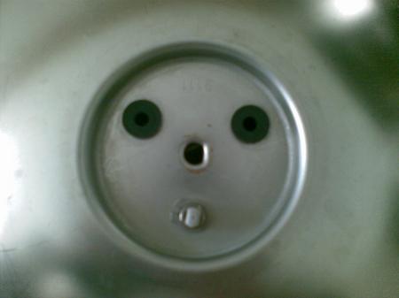Ein Gesicht im Schnellkochtopf(-Deckel)